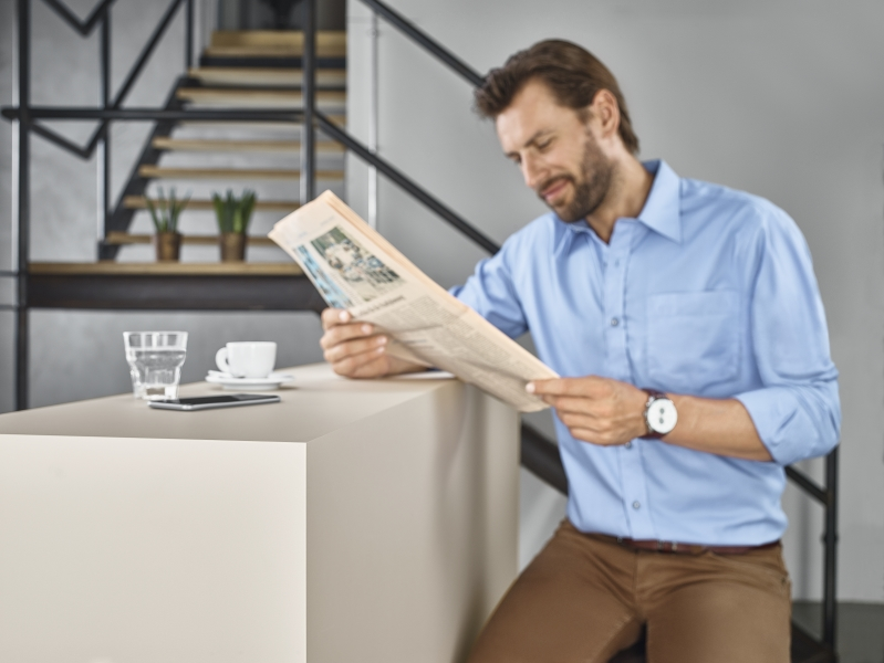 Coffee shop counter with man reading newspaper showing coloured core in application, U7021 ST9 Solid Cashmere